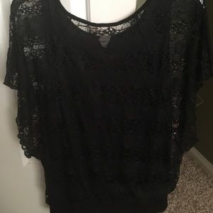 Tops - Cute lace lined blouse with open sleeves.